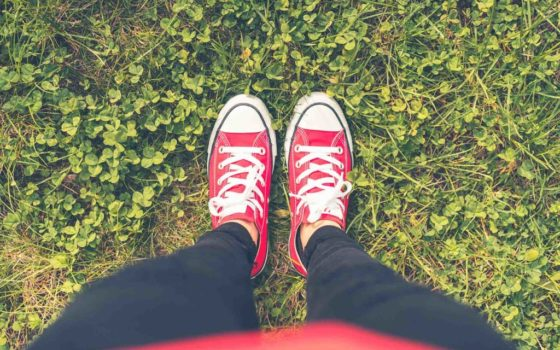 girl-with-red-shoes-in-grass-fpv-picjumbo-com2